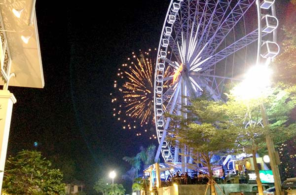 The ferris wheel and fireworks at Asiatique