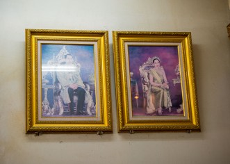 Portraits of the King and Queen at our second food tour stop