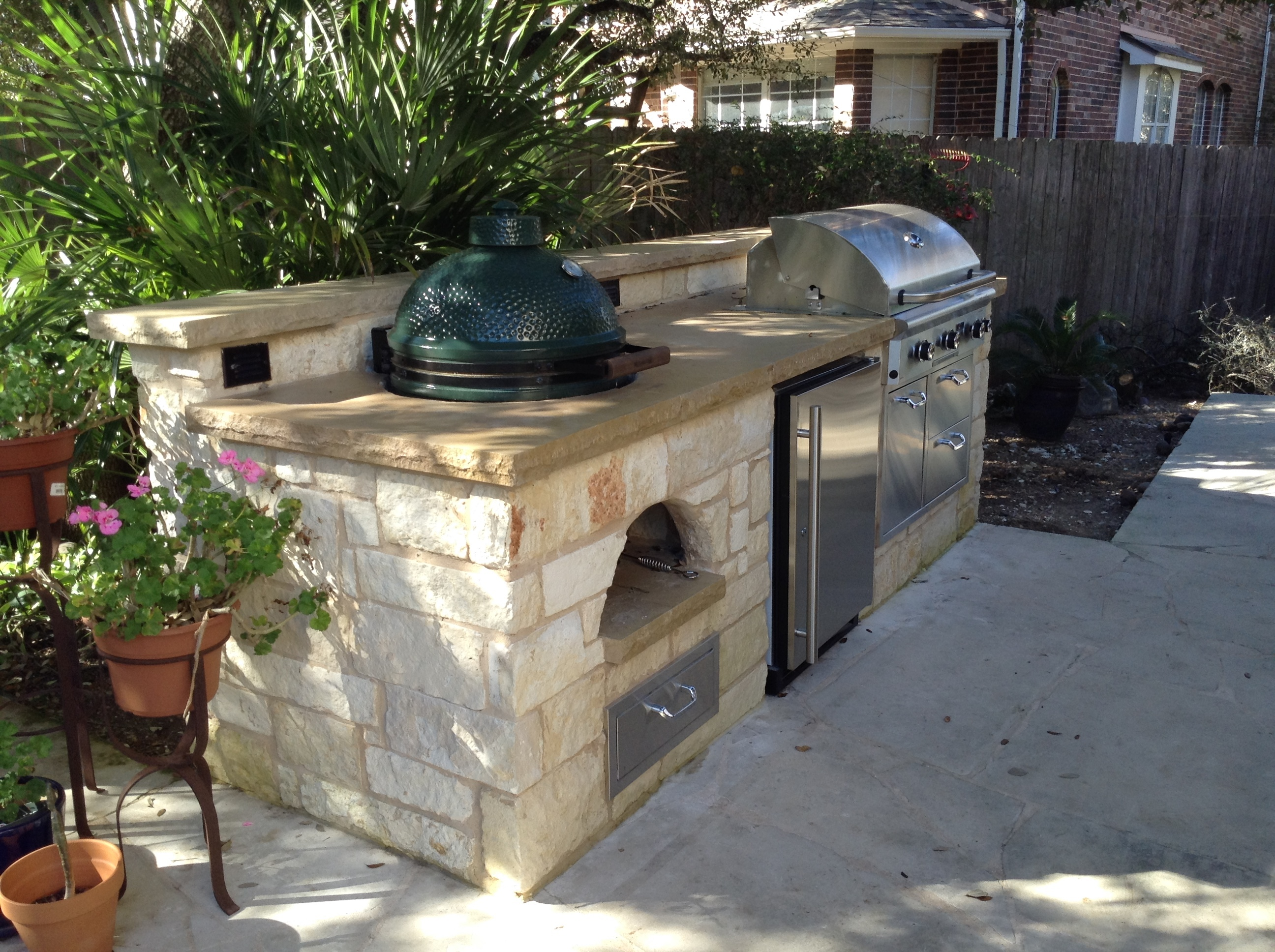 red stone outdoor kitchen rustic countertops austin decks pergolas covered