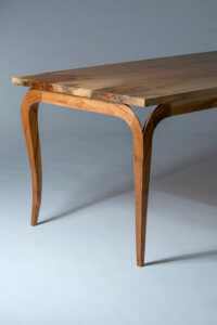 pecan dining table on gray background by aaron fox austin school of furniture and design