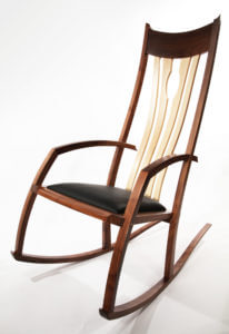walnut and leather rocking chair by Philip Morley