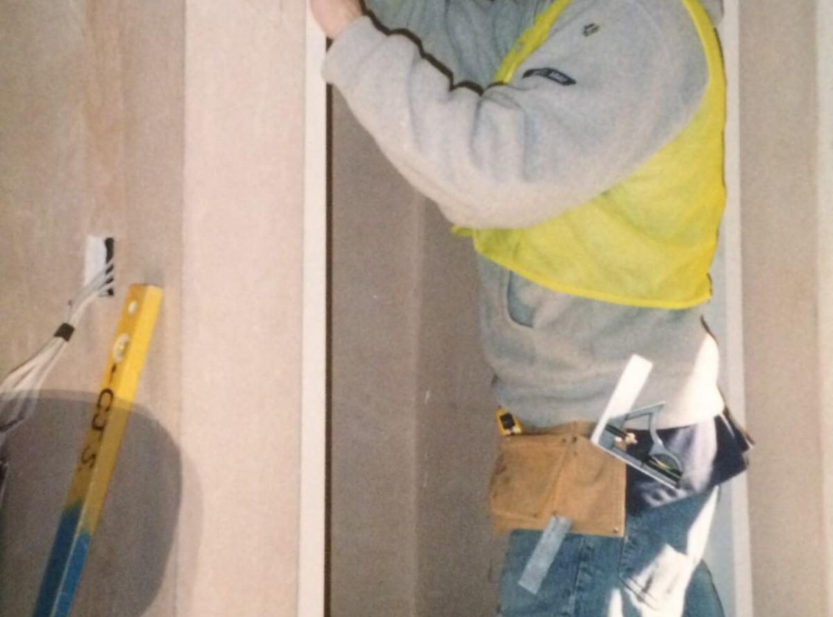 carpenter student working on framing a doorway