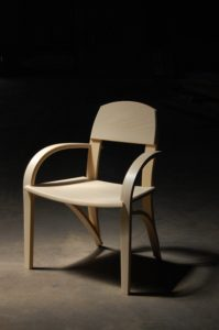 light colored chair with dark background austin school of furniture and design