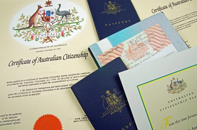 Close up of Australian Southern Cross flag with Australian passport for Australian travel event