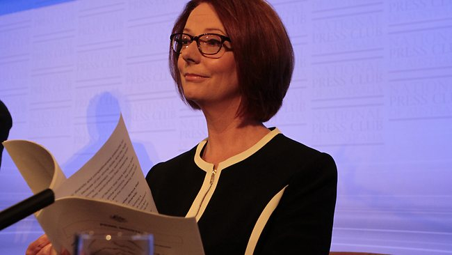 Gillard examines Swan's Budget