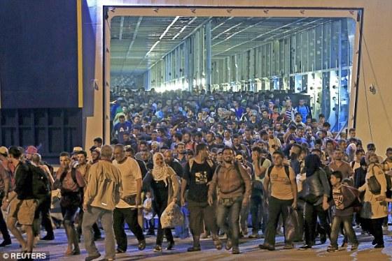 Muslim Illegals storm ashore at Greeces Port of Piraeus