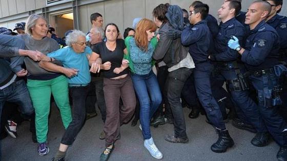 Mel Gregson tug-o-war with Police