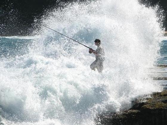 Happy Asian Rock Fisherman