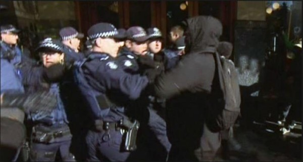 Victoria Police attacked by masked protesters