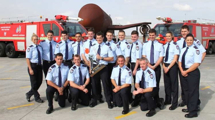 The graduating class from Airservices fire fighting course at Melbourne Airport in 2015. (Airservices)