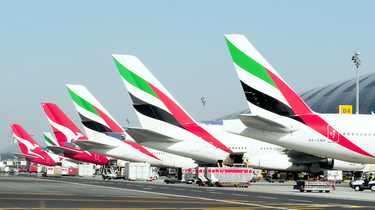 Qantas aircraft alongside Emirates aircraft at Dubai Airport. (Qantas)
