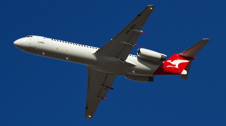 Network Aviation Fokker F100 VH-NHY takes off from Townsville after being painted in QantasLink colours. (Dave Parer)