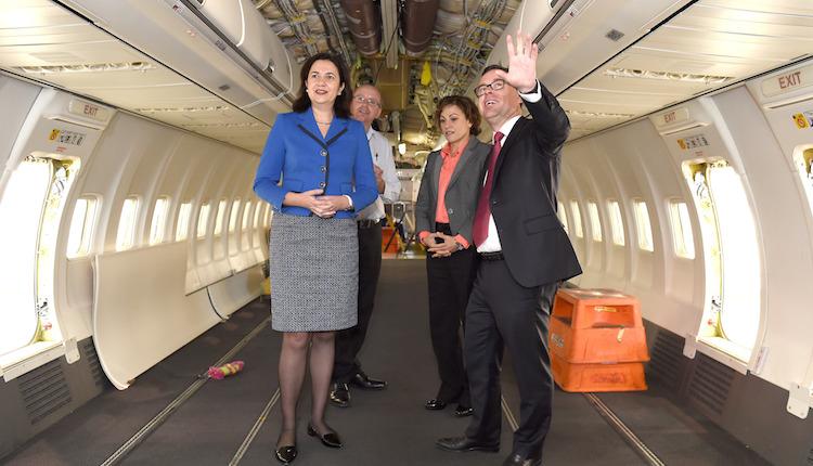 Queensland Premier Annastacia Palaszczuk and Qantas chief executive Alan Joyce inspect a Qantas Boeing 737-800 at Brisbane. (Qantas)