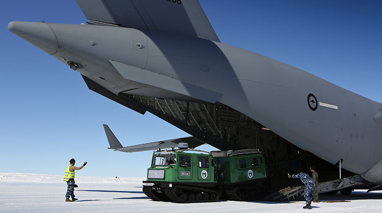 A Hägglunds snow vehicle is driven off a C-17A Globemaster at Wilkins Aerodrome.