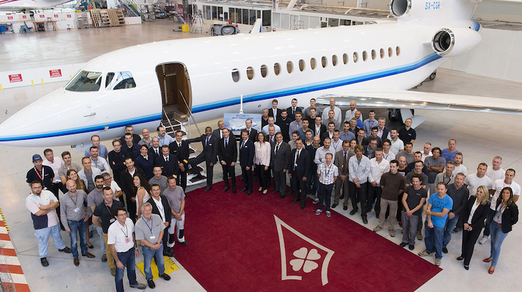 Dassault and Amjet staff celebrate the delivery of the Falcon 8X. (Dassault)