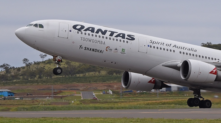 To mark the one-off charter, the Qantas Airbus A330-300 VH-QPA was decorated with special decals and logos. (Lenn Bayliss)