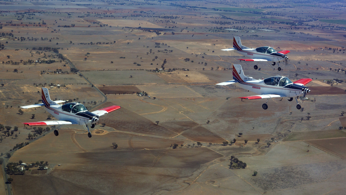 Basic Flying Training School CT-4 aircraft participate in a formation flypast over Tamworth, New South Wales. (Defence)