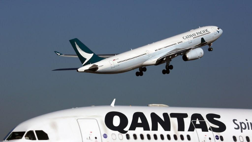 A file image of Cathay Pacific and Qantas aircraft at Sydney Airport. (Rob Finlayson)