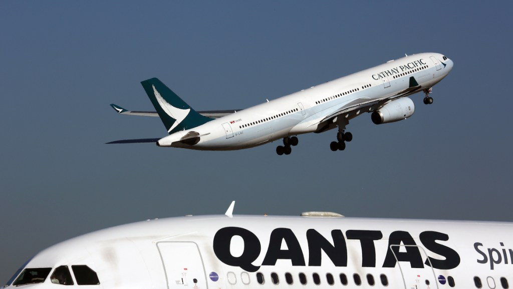 A file image of Cathay Pacific and Qantas aircraft at Sydney Airport. (Rob Finlayson)