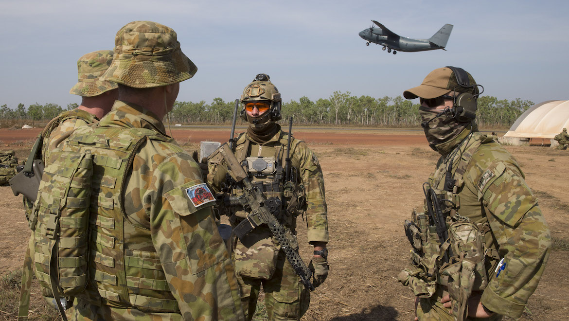 A RAAF Combat Control Team hands over 'control' of Batchelor airfield to 382 Squadron and Security Forces during Pitch Black. (Defence)