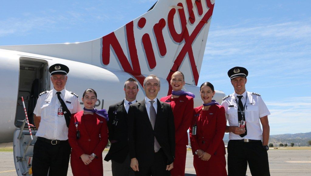 A 2015 file image of Virgin Australia chief executive John Borghetti with pilots and cabin crew at Tamworth Airport. (Virgin Australia)