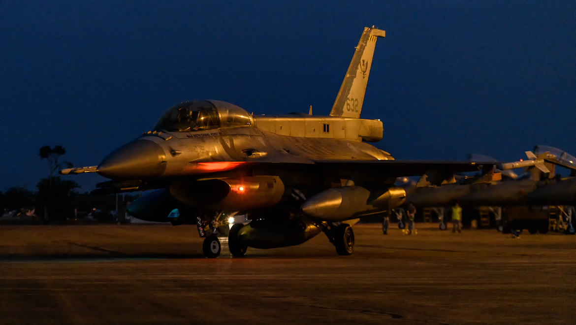 A RSAF F-16D taxis out for a night-time mission. (Mark Jessop)