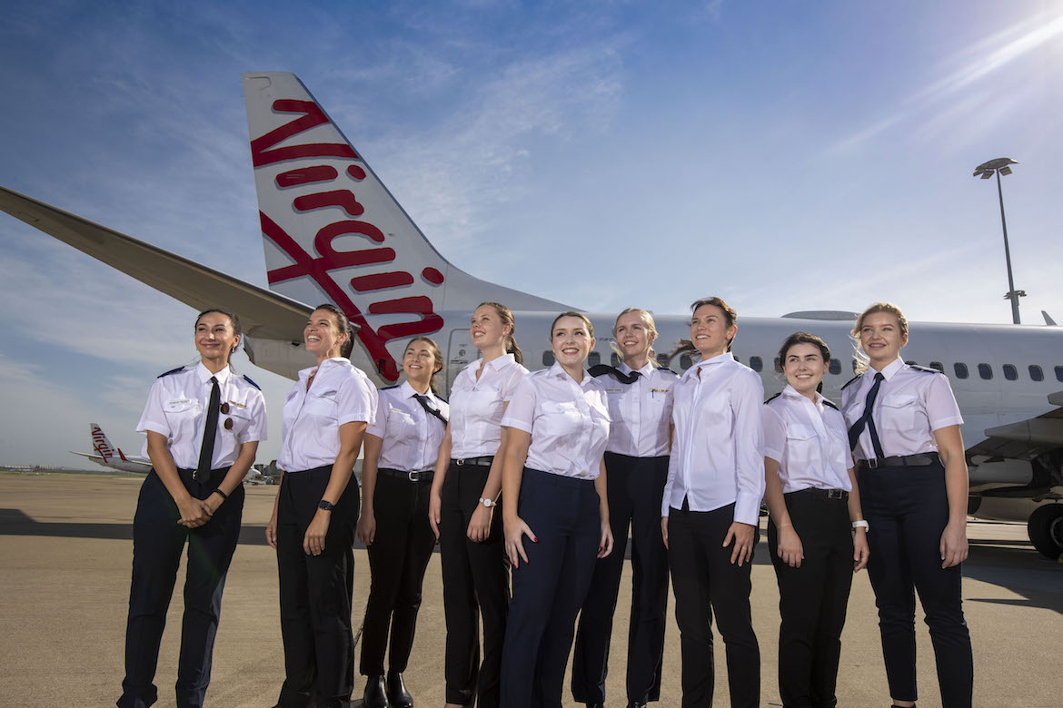A supplied image of Virgin Australia pilot recruits Jade Reinbott, Rebecca Lonergan, Abby Toten, Olivia Walters, Inez Leggett, Kate Richards, Sarsha Pincini, Ami Love and Briana Nicholson. (Glenn Hunt/Virgin Australia)