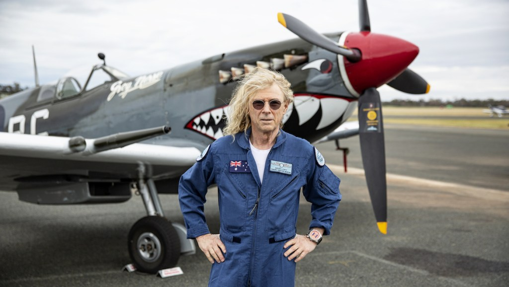 David Lowy in front of his Spitfire. (Temora Aviation Museum)