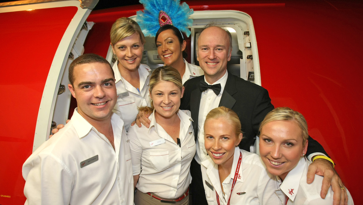 Brett Godfrey with Virgin Blue flight attendants at the September 2007 launch of Canberra-Sydney E-Jet flights. (Paul Sadler)