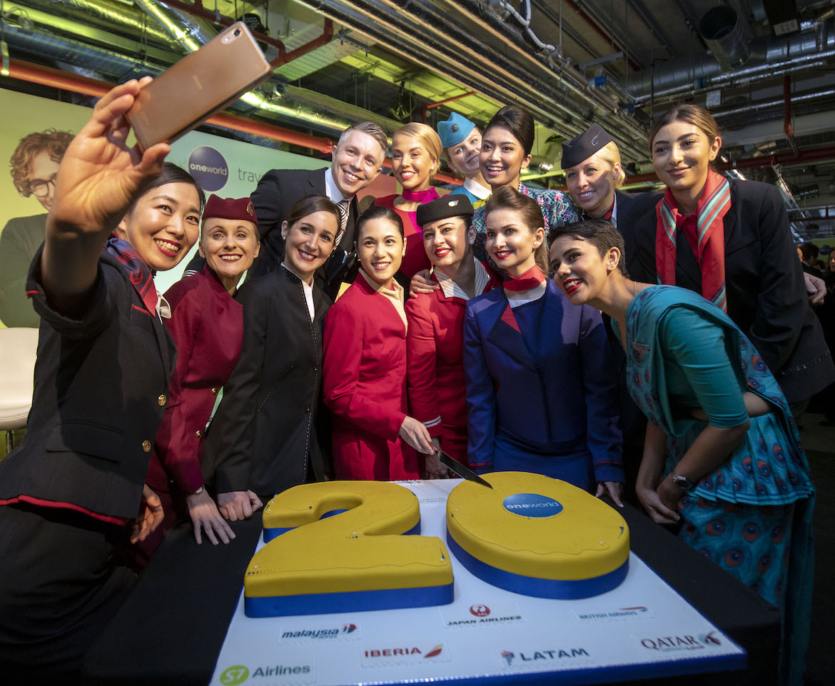 Cabin crew from oneworld member airlines celebrate the alliance's 20th birthday. (oneworld)