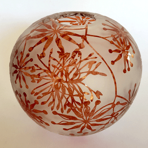 Firewheel sphere by Amanda Louden. Blown and etched glass.