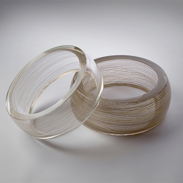Sentiment by Laurel Kohut. Pair of blown and cold worked glass rings. Sculpture.