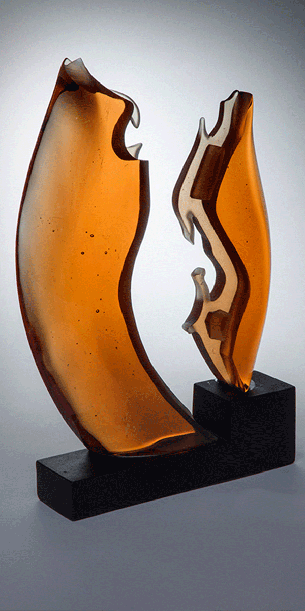 She Danced (margins series) by Ruth McCallum Howell. Cast glass on glass base.