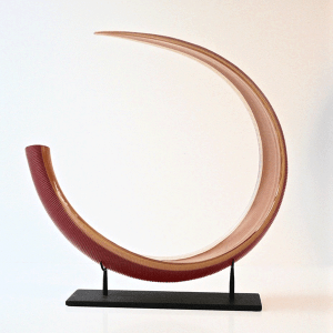 Red Curled Leaf with yellow cane by Ben Edols and Kathy Elliott. Blown and carved glass on metal stand.