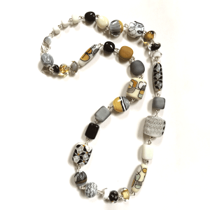 Ivory, greys and gold coloured handmade glass beads by Lisa Simmons with sterling silver fittings. Length 68cm