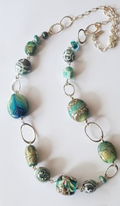 Jade green flame formed necklace by Lisa Simmons