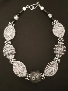 Black and white blown glass beads by Susie Barnes