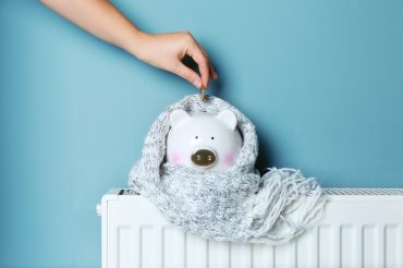 Piggy bank on top hydronic heating panel