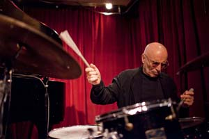 Paul Motian performing with pianist Dan Tepfer, at the Cornelia Street Cafe in Manhattan Feb 2011  © John Rogers