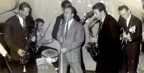 Johnny O'Keefe singing with band