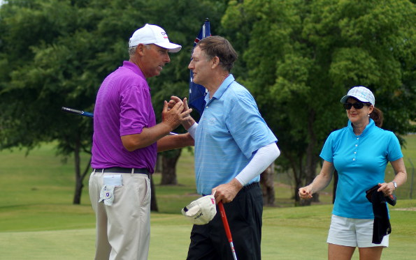 Mike Harwood (left) congratulates Owen after the Kiwi birdied their first playoff hole to win the championship.