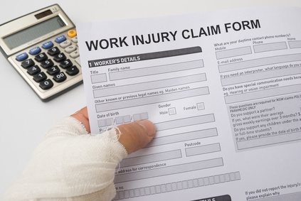 hurted hand holding a work injury claim form