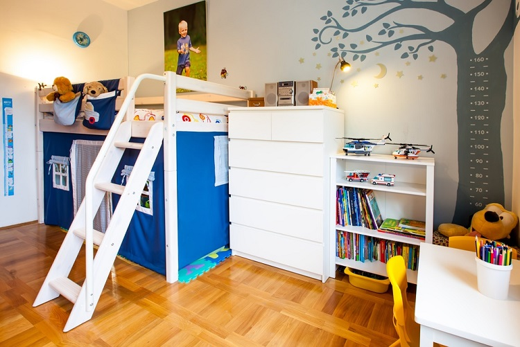 Boy's room with house playground and tree with lost of toys