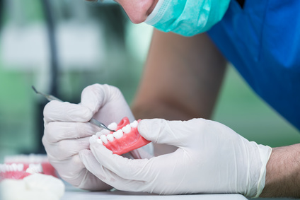 Making A Choice Between Dental Implants And Dentures