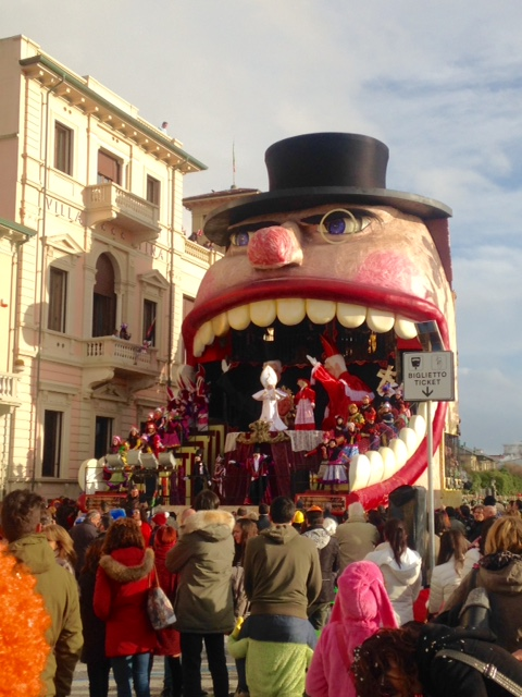 The floats are very tall and include a lot of dancers.