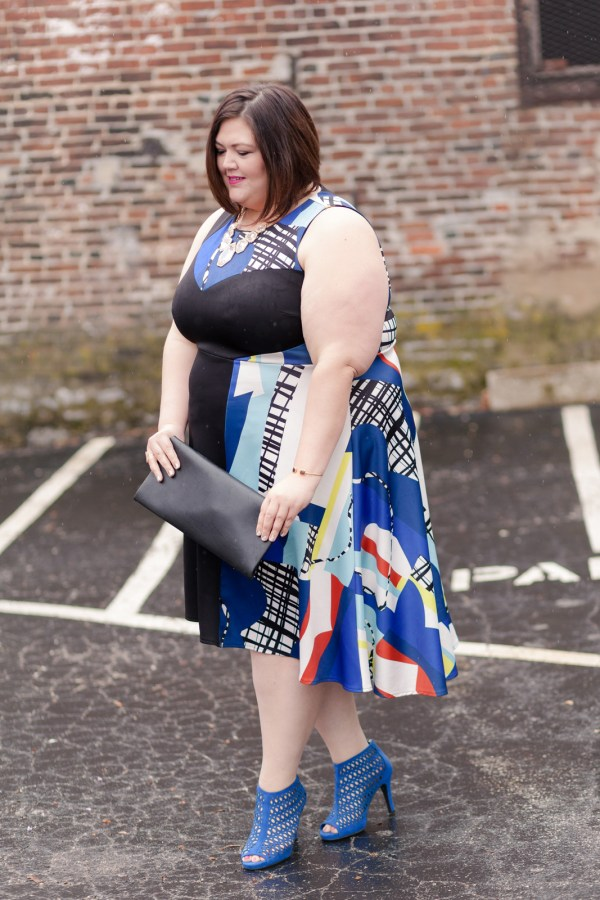 Emmie in the ELOQUII Abstract Print Asymmetrical Dress