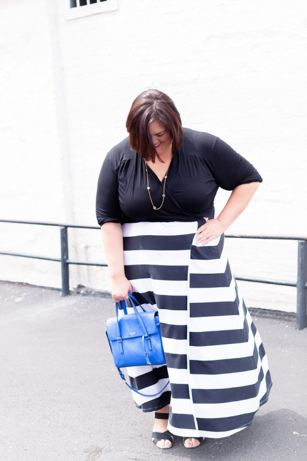 Plus size fashion blogger Authentically Emmie in a Rebdolls dress