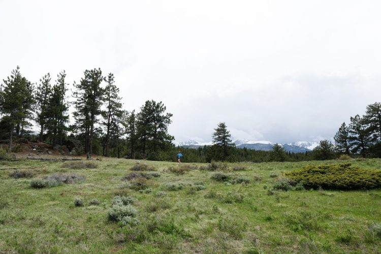 Caroline Whatley running in Rocky Mountain National Park