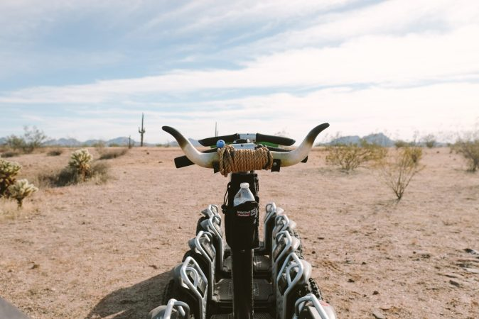 A photo of a Segway in the desert