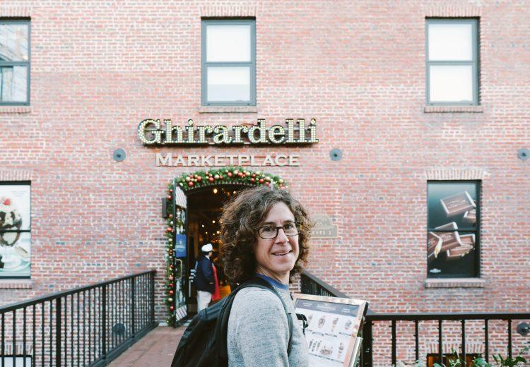 Caroline Whatley standing outside Ghiradelli Marketplace in San Francisco